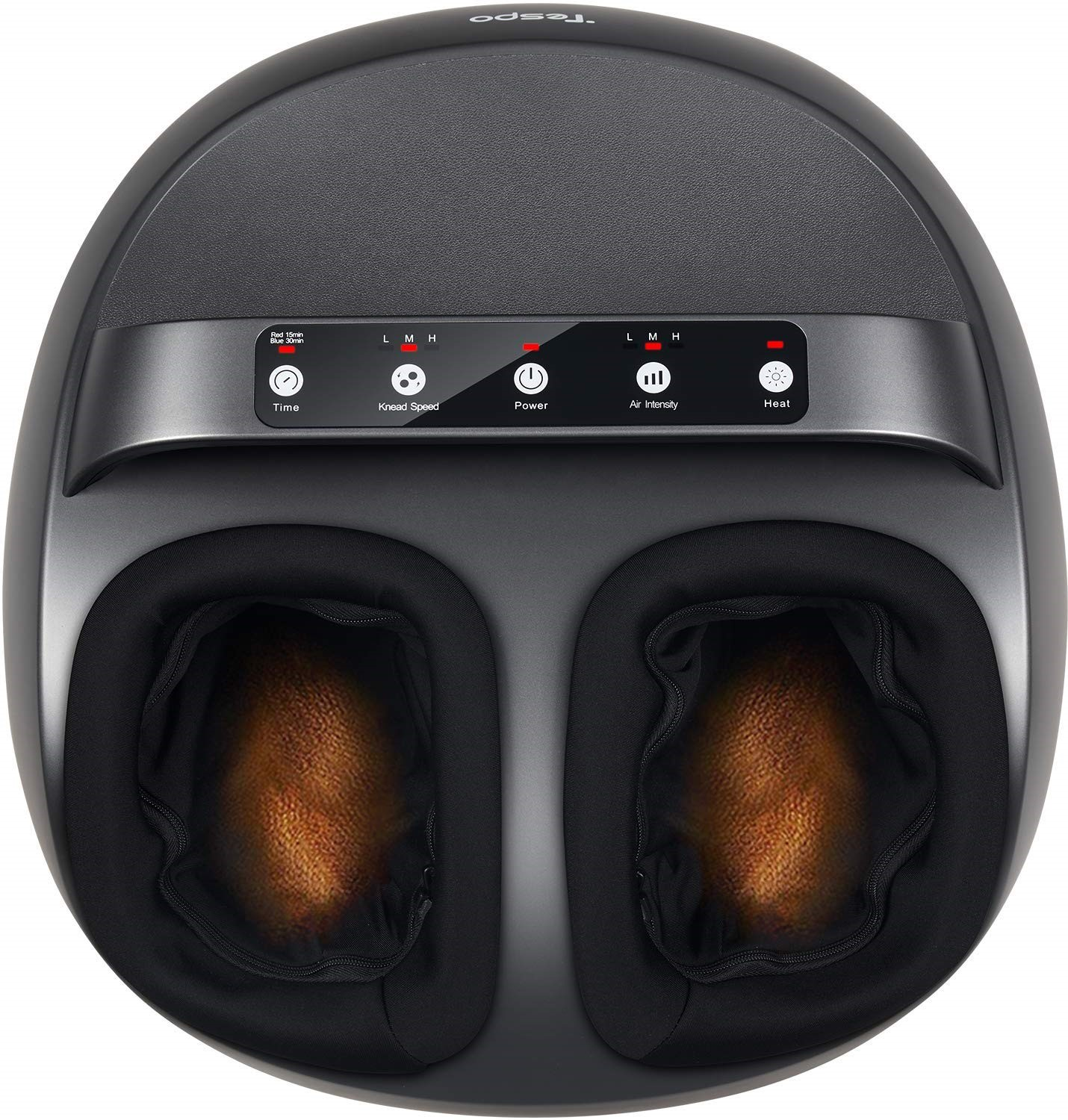 Top view of black, rounded machine with a row of buttons across the top and spaces to insert feet below.