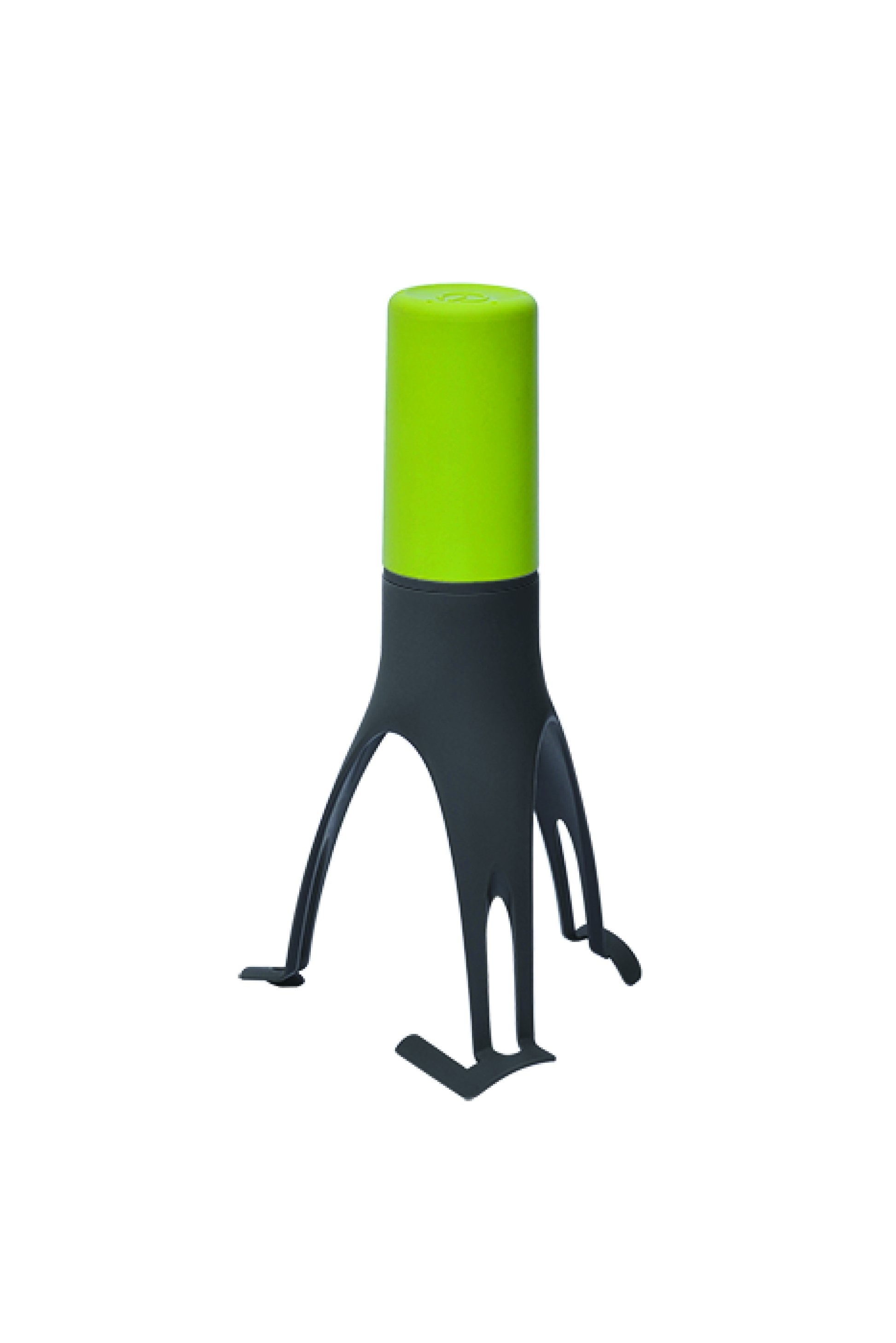 Black kitchen gadget standing upright on three legs, with bright, light green handle at top.